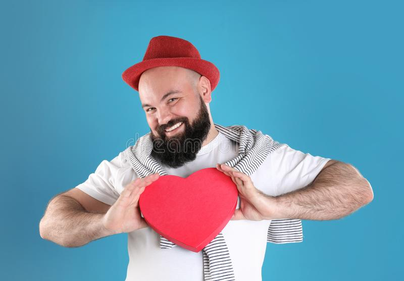 Emotional man with heart shaped box stock photo