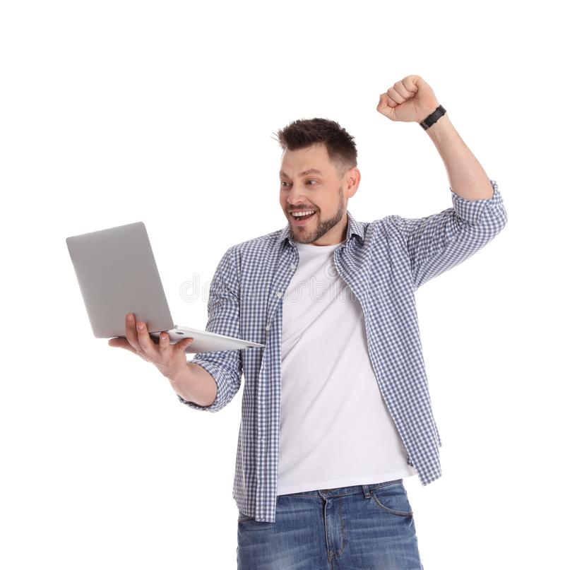 Emotional man with laptop on white royalty free stock photo