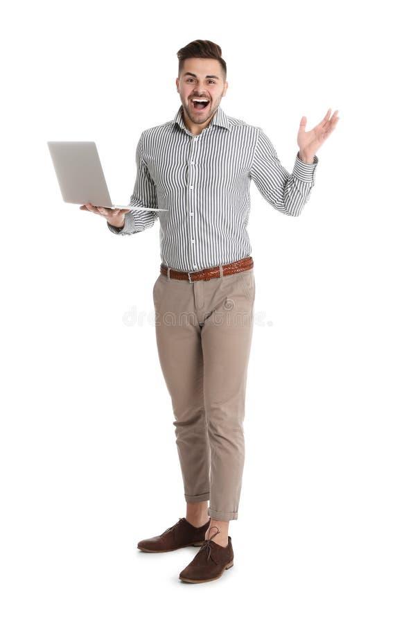 Emotional man with laptop on white stock photos