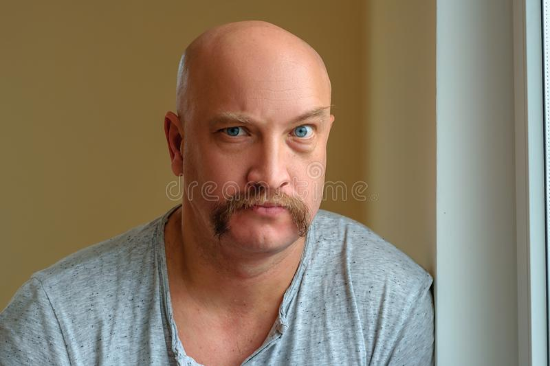 An emotional man with a mustache different facial expressions on the face royalty free stock photography