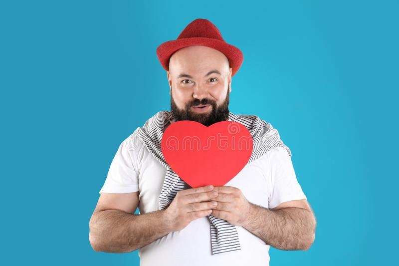 Emotional man with paper heart stock images