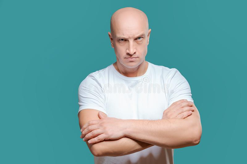 Emotional man in white t-shirt with angry facial expression on background, isolation royalty free stock images