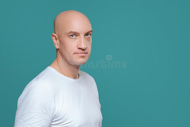 Emotional man in white t-shirt with angry facial expression on background, isolation royalty free stock photography
