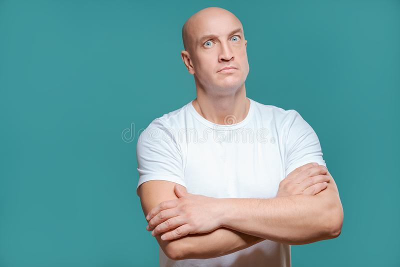 Emotional man in white t-shirt with angry facial expression on background, isolation royalty free stock photo