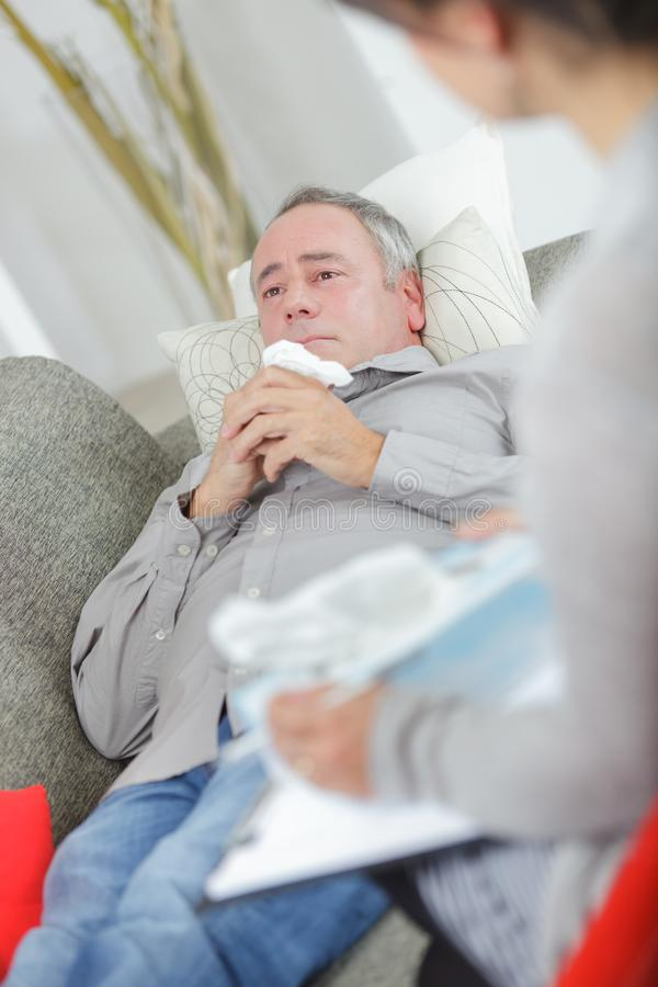 Emotional middle-aged man talking to therapist royalty free stock photos