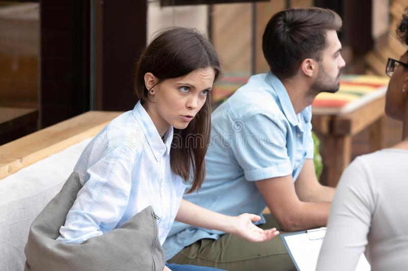 Couple visiting relationships specialist discussing marriage problems royalty free stock photography