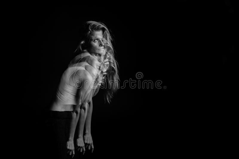 Emotional mystical female portrait of psychosis excitement, uncertainty, feelings, discomfort. Black and white photo royalty free stock photography