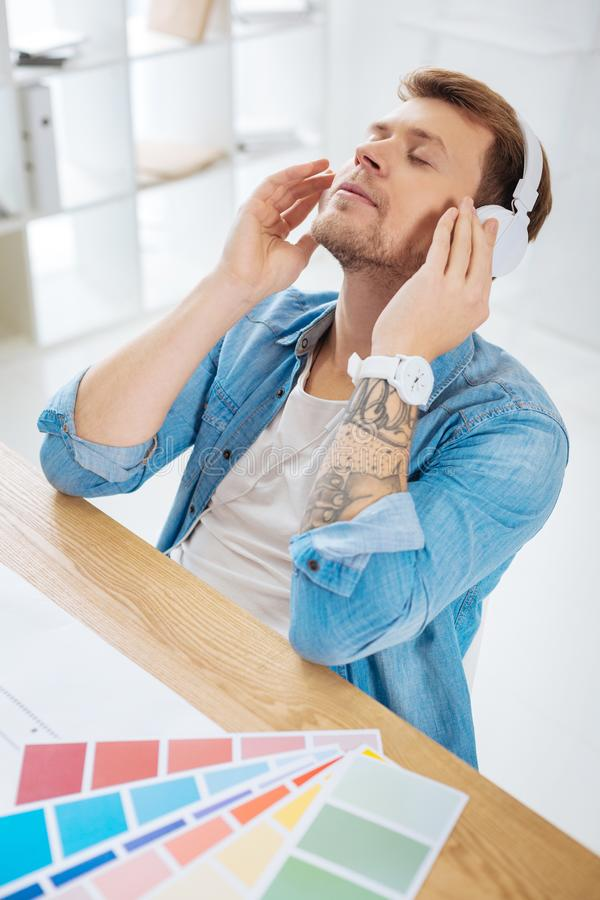 Emotional office worker listening to music and relaxing royalty free stock images