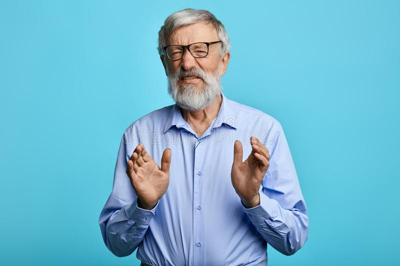Emotional old man is afraid of somebody stock photography