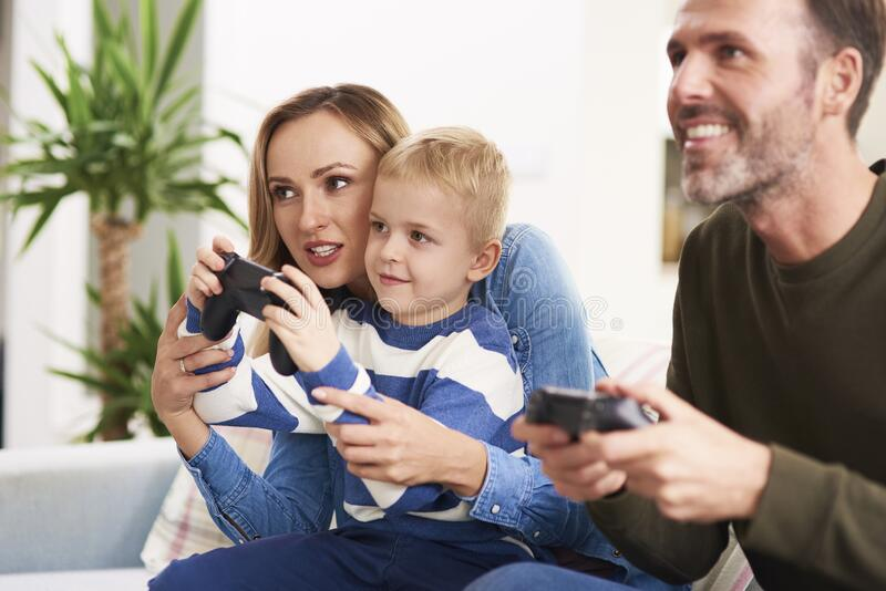 Family playing video game royalty free stock images