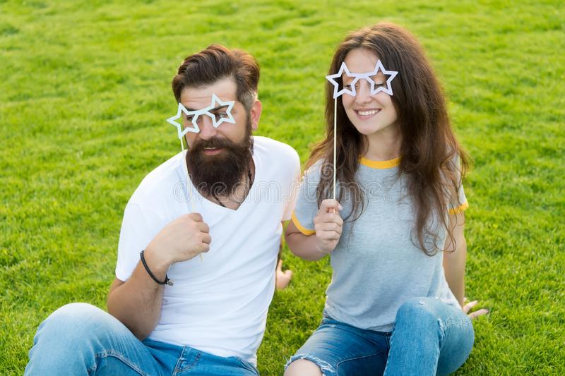Emotional people. Couple dating. Carefree couple having fun green lawn. Man bearded hipster and pretty woman cheerful royalty free stock photos