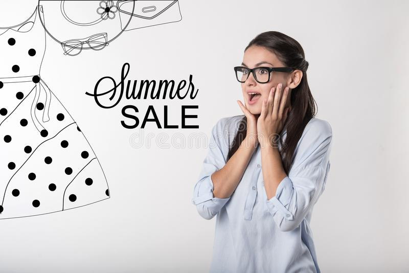 Emotional person feeling surprised when noticing amazing summer sale stock photography