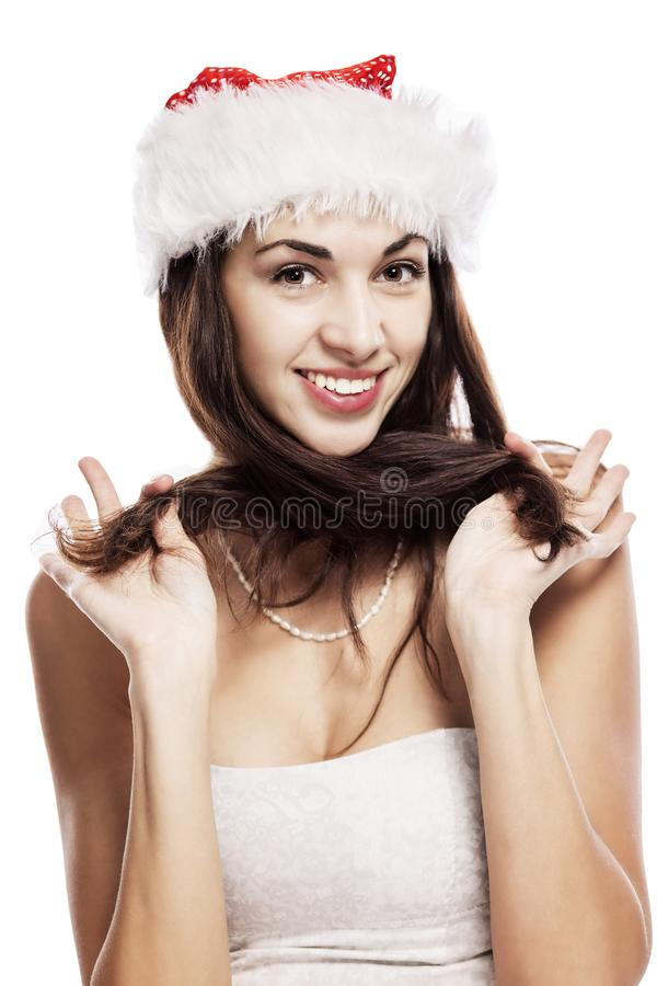 Emotional portrait of a beautiful young woman in a Santa Claus hat. New Year mood. Isolated over white background. royalty free stock photography