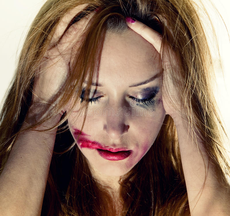 Emotional portrait of depression woman. Emotional portrait of t depression woman with with flowing makeup stock photography