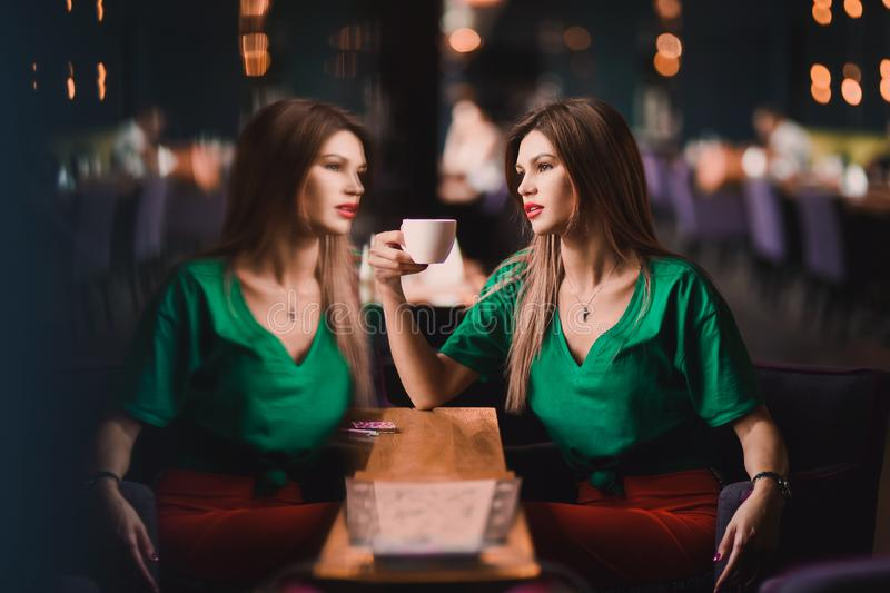 Portrait of Fashion stylish of young hipster blonde woman, elegant lady, green top and red skirt, cool girl. City view urb stock photos