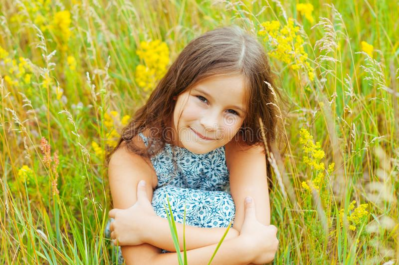 Emotional portrait of a little girl in the field enjoying the summer royalty free stock images