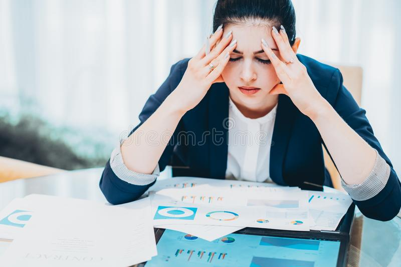 Pressure deadlines stressed business woman office. Emotional pressure and deadlines. Portrait of stressed out business woman sitting with papers at office stock images
