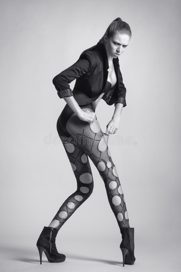 Emotional woman with long legs in stockings. Fashion girl stock photography