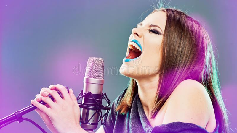 Emotional singer. Young woman. royalty free stock images