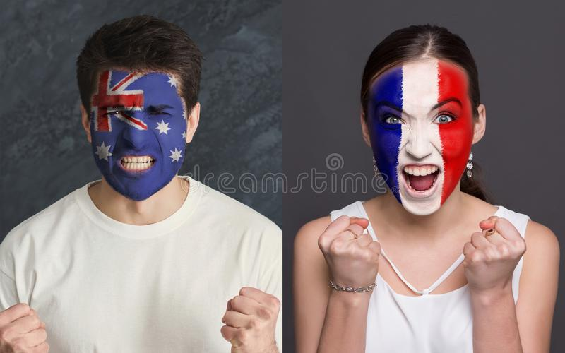 Emotional soccer fans with painted flags on faces. Emotional soccer fans with painted Australia and France flags on faces. Confrontation of football team royalty free stock images