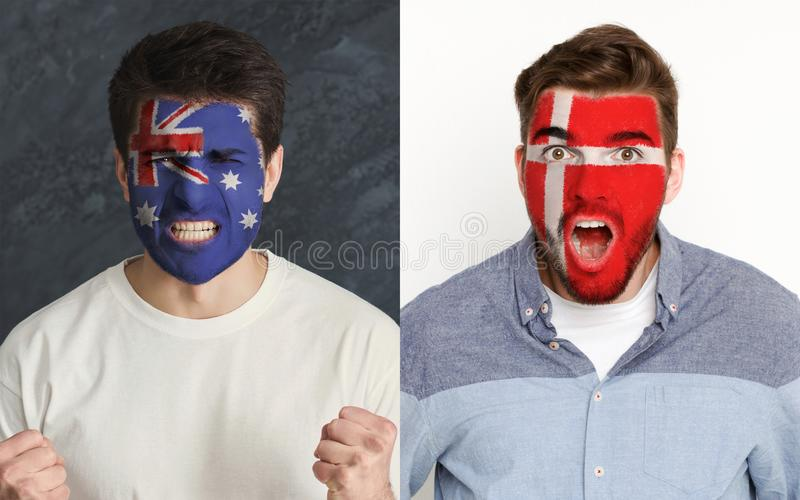 Emotional soccer fans with painted flags on faces. Emotional soccer fans with painted Australia and Denmark flags on faces. Confrontation of football team stock images