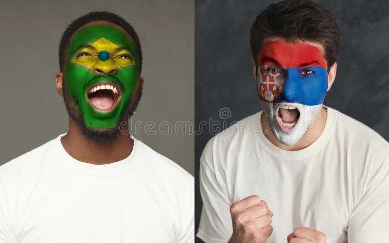 Emotional soccer fans with painted flags on faces. Emotional soccer fans with painted Brazil and Serbia flags on faces. Confrontation of football team supporters stock images