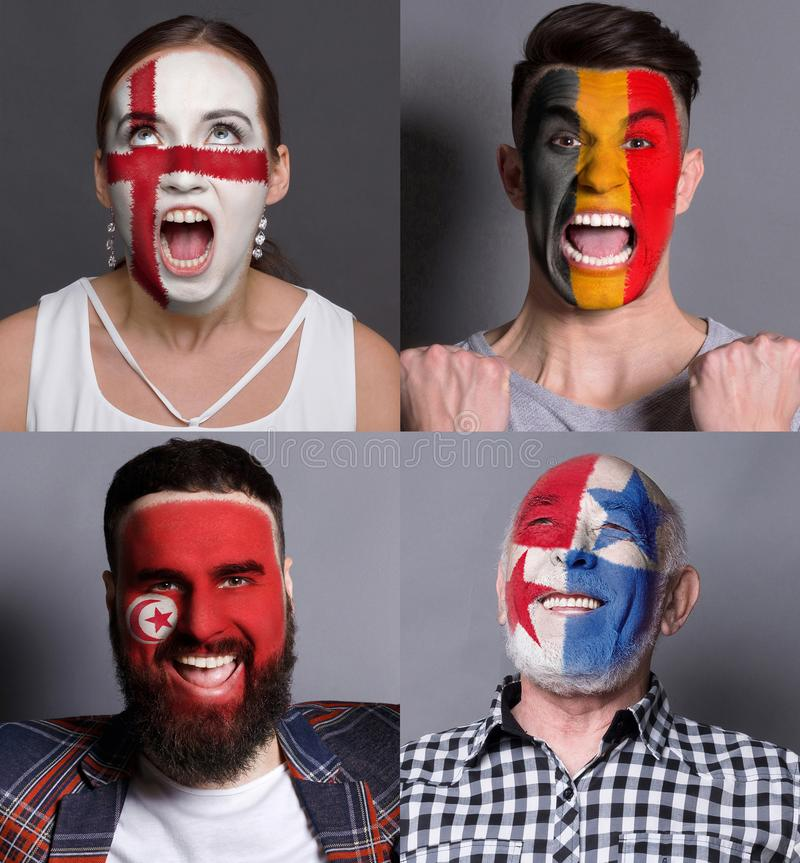 Emotional soccer fans with painted flags on faces. Emotional soccer fans with painted flags of Belgium, England and Tunisia on faces. Rooters of football stock photography
