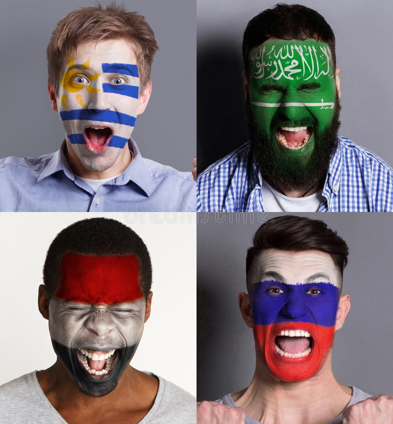 Emotional soccer fans with painted flags on faces. Emotional soccer fans with painted flags of Russia, Saudi Arabia, Egypt and Uruguay on faces. Rooters of royalty free stock photography