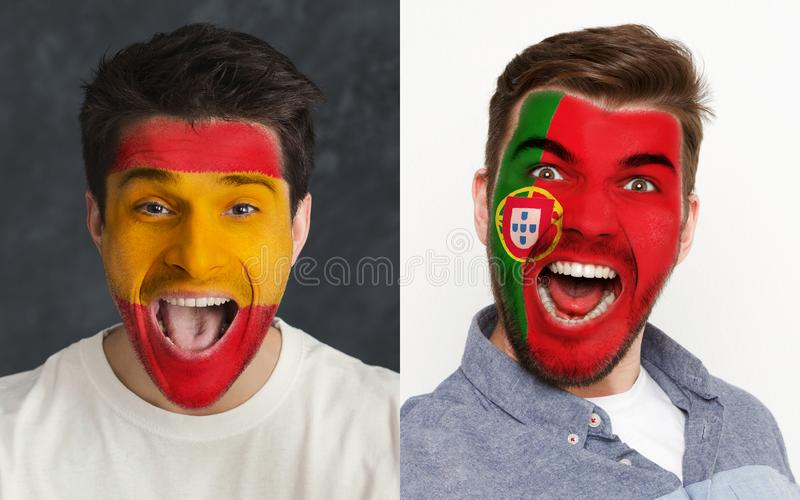 Emotional soccer fans with painted flags on faces. Emotional soccer fans with painted Spain and Portugal flags on faces. Confrontation of football team stock images