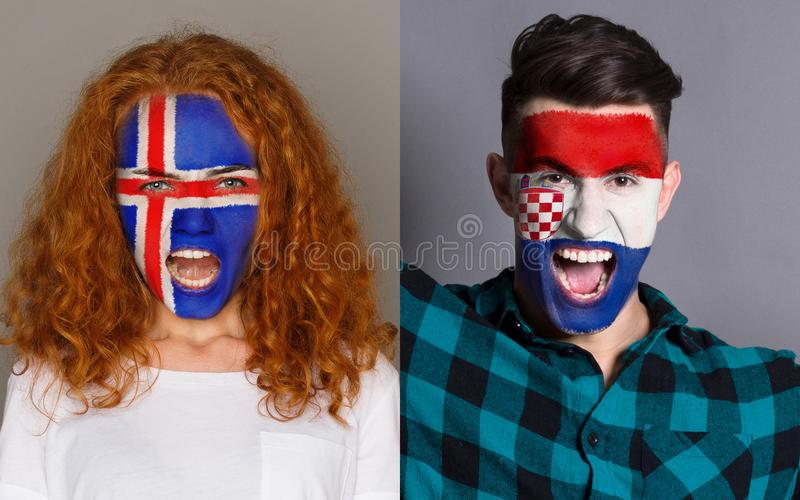 Emotional soccer fans with painted flags on faces. Emotional soccer fans with painted Iceland and Croatia flags on faces. Confrontation of football team stock photography