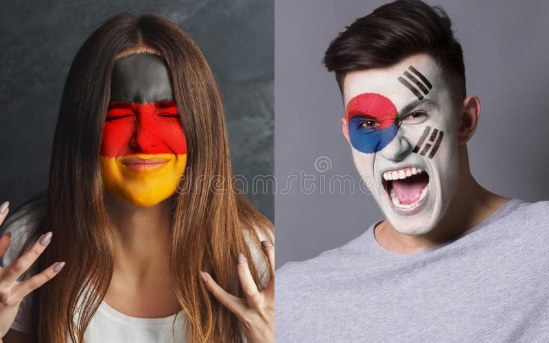 Emotional soccer fans with painted flags on faces. Emotional soccer fans with painted South Korea and Germany flags on faces. Confrontation of football team stock image