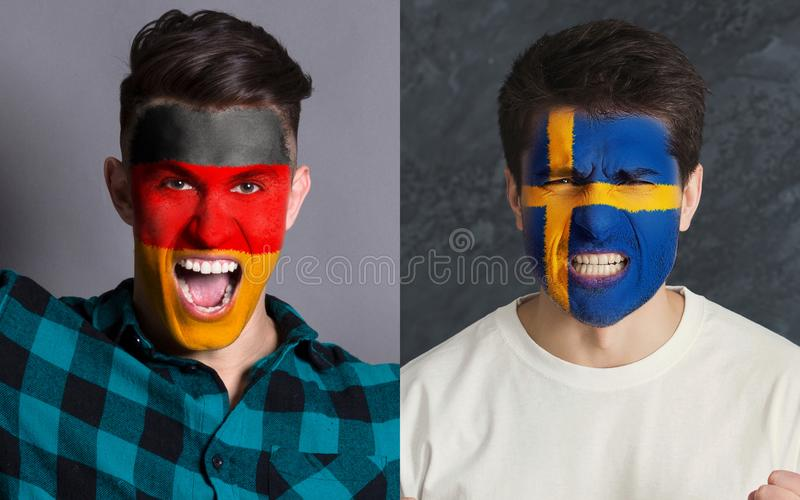 Emotional soccer fans with painted flags on faces. Emotional soccer fans with painted Germany and Sweden flags on faces. Confrontation of football team stock image