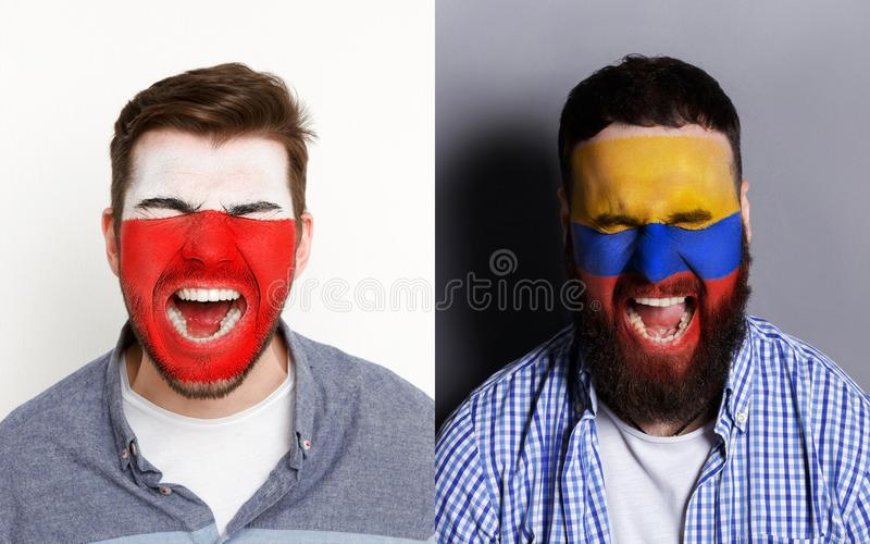 Emotional soccer fans with painted flags on faces. Emotional soccer fans with painted Poland and Columbia flags on faces. Confrontation of football team stock images