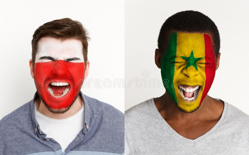 Emotional soccer fans with painted flags on faces. Emotional soccer fans with painted Poland and Senegal flags on faces. Confrontation of football team royalty free stock photos