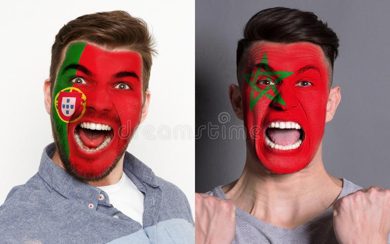 Emotional soccer fans with painted flags on faces. Emotional soccer fans with painted Portugal and Morocco flags on faces. Confrontation of football team royalty free stock photography