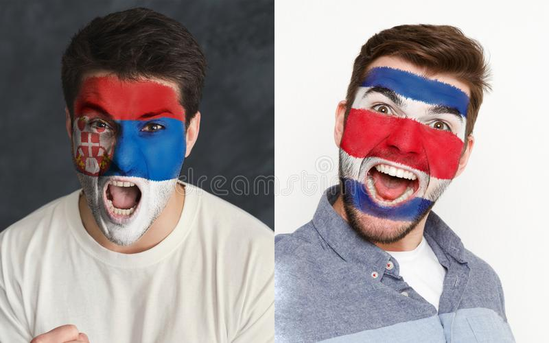 Emotional soccer fans with painted flags on faces. Emotional soccer fans with painted Serbia and Costa Rica flags on faces. Confrontation of football team stock photography