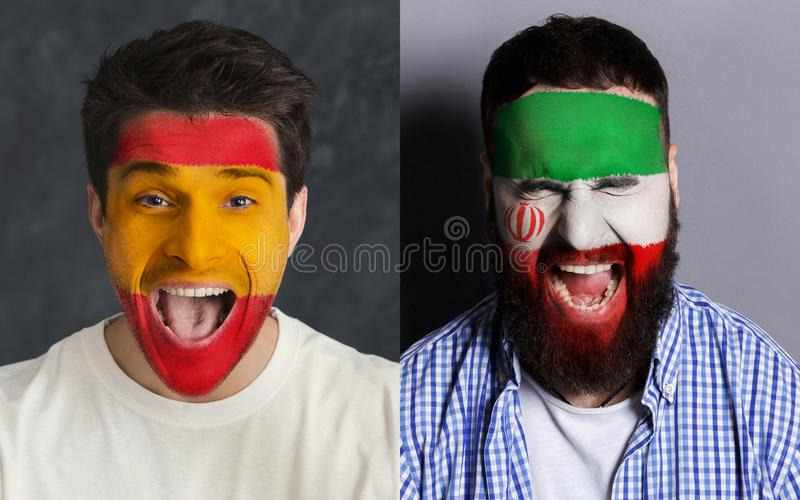 Emotional soccer fans with painted flags on faces. Emotional soccer fans with painted Spain and Iran flags on faces. Confrontation of football team supporters stock images