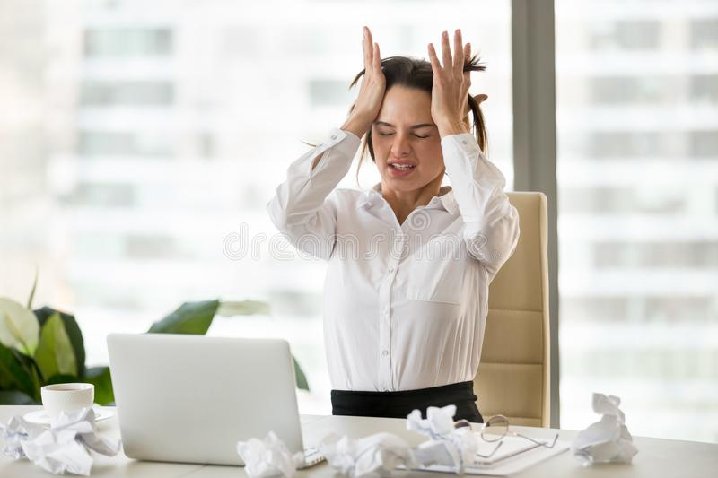 Emotional stressed businesswoman having nervous breakdown after stock images