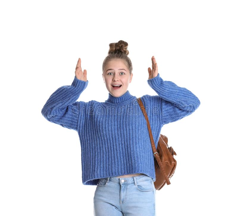 Emotional teenage girl with backpack on royalty free stock photography