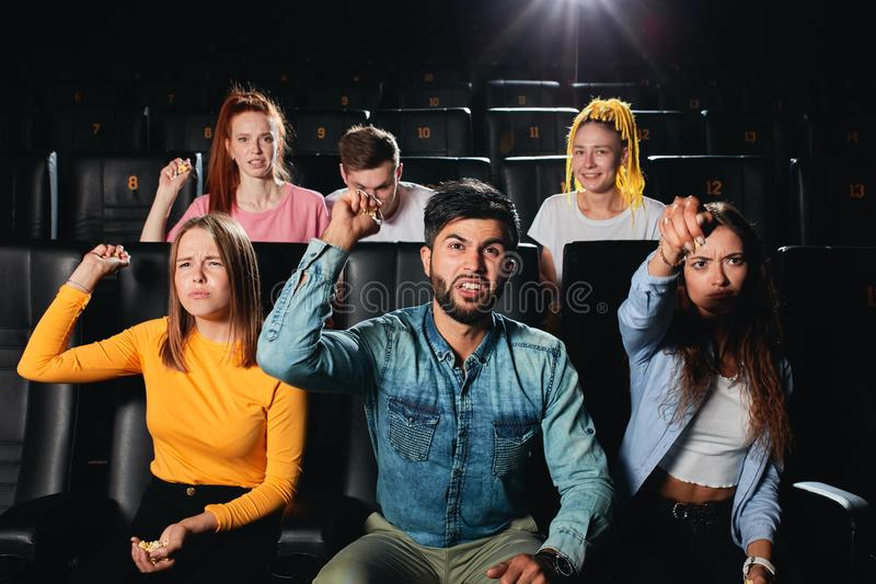 Emotional teenagers are being distressed for main heroes of film. Audience isn`t satisfied with the action royalty free stock images