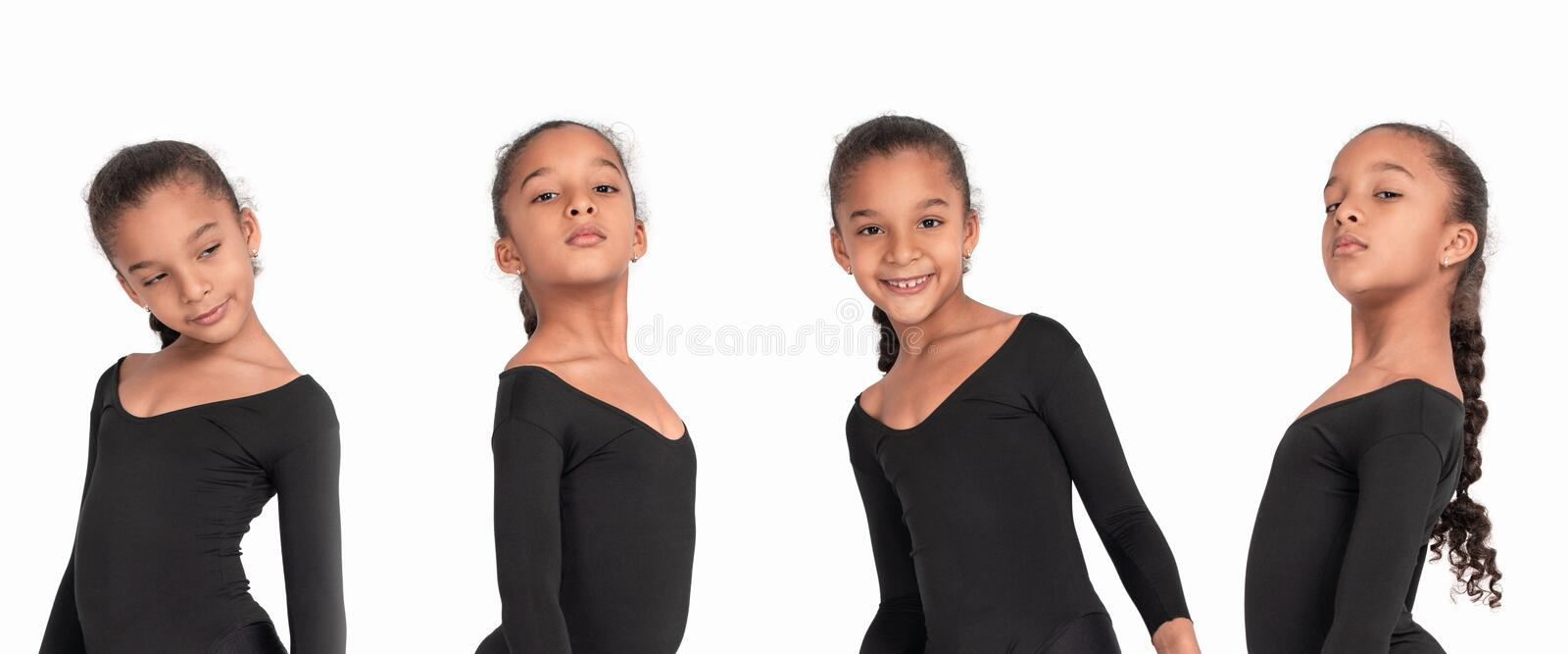 Emotional studio shoot of the little girl of the mulatto in a gymnastic suit on a white background stock photo