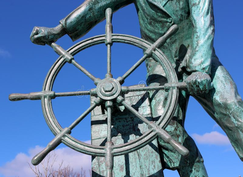 Emotional statue of sailor at the helm, honoring ones lost at sea, Fisherman`s Memorial, Gloucester, Mass, 2018 stock photos