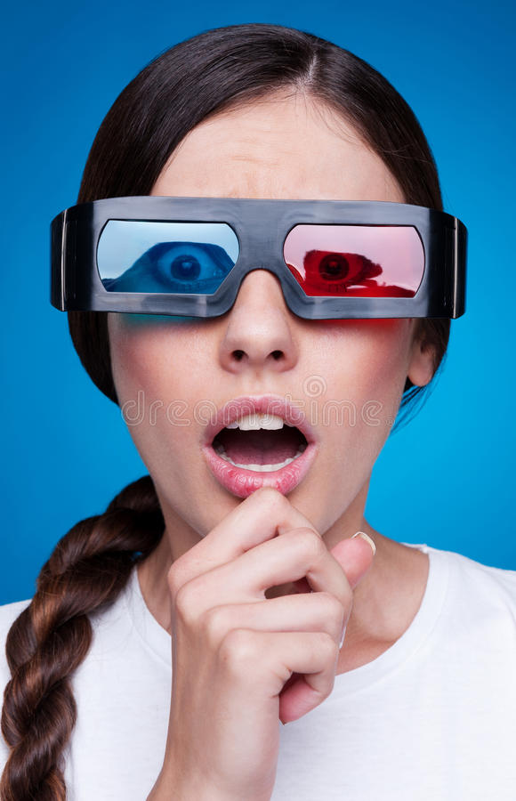 Emotional woman in 3d glasses royalty free stock image