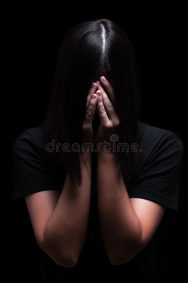 Emotional woman crying and covering the face with the hands hiding the tears royalty free stock photos
