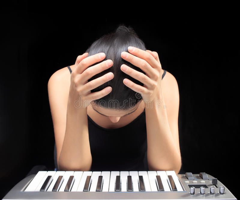 Emotional woman learning to play the piano. royalty free stock photos