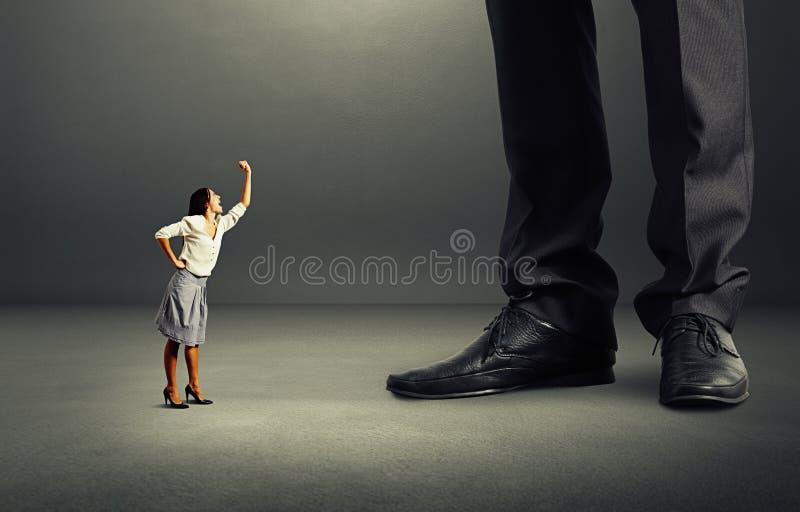 Emotional woman screaming at big man royalty free stock photography