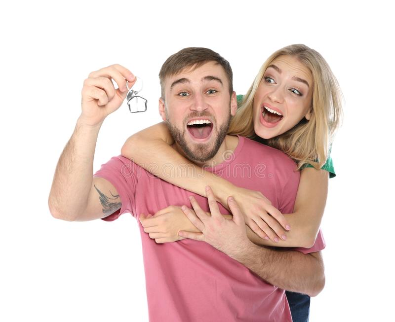 Emotional young couple with house key. On white background royalty free stock photography