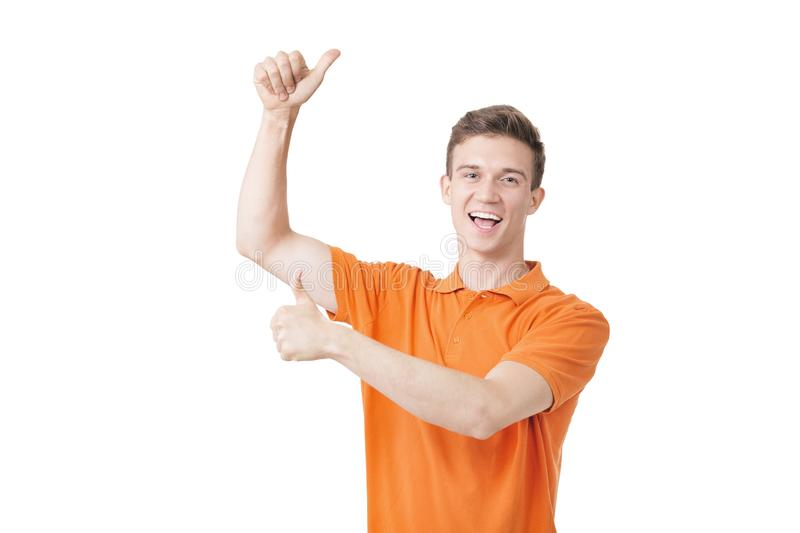 Emotional young man with brown hair screaming and raising hands in the air, feeling excited. Success concept stock photo