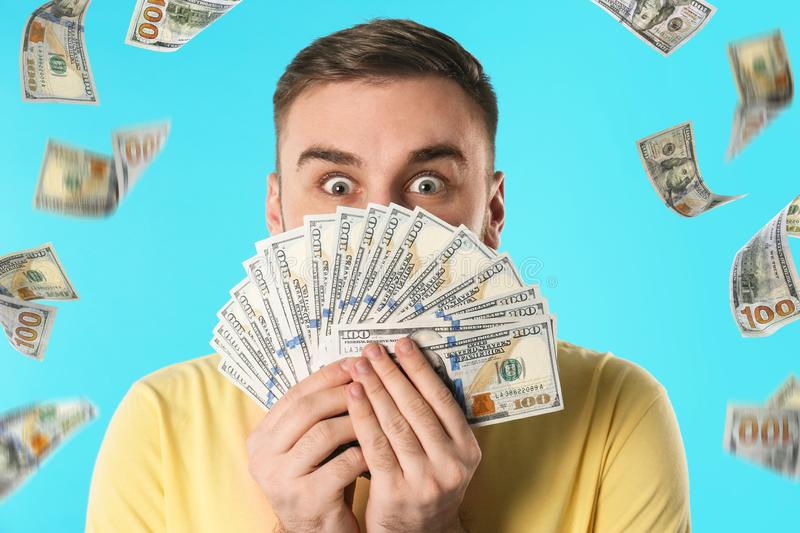Emotional young man with money stock photos