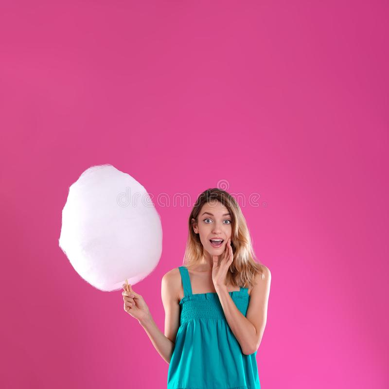 Emotional young woman with cotton candy royalty free stock images